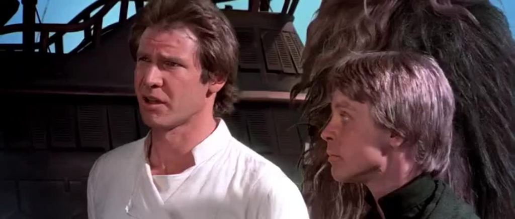 Screenshot from Return of the Jedi: closeup of Han and Luke having a conversation outside